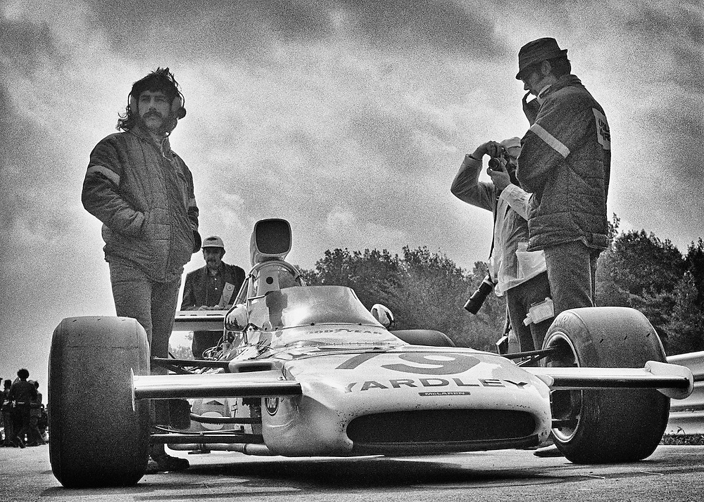 The way it used to be, 1972. <br /> <br /> One lone mechanic with Denny Hulme&rsquo;s race-ready Yardley Team McLaren-Ford M19C. One journalist. One photographer. <br /> <br /> Forty years ago, looking at the starting grid for the 1972 United States Grand Prix, no one could have dreamed of the changes that would occur to this team, to this sport, and to the drivers and their machines by the end of the decade, not to mention the world-wide business spectacle of Formula 1 today. <br /> <br /> Nothing will ever be both this simple and this profound again.