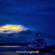 """In this """"Signature Series"""" image by David Longstreath a ferry boat crosses the Mekong River near Phnom Penh, Cambodia."""