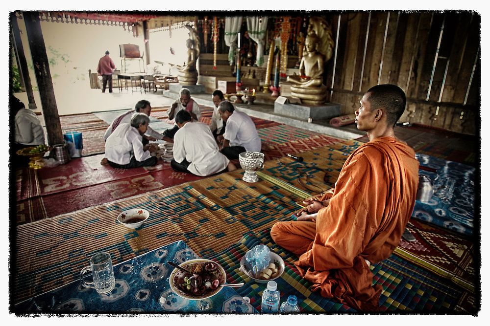 A Cambodian Buddhist monk looks on during a merit making ceremony in Pailin along the Thai-Cambodian border.