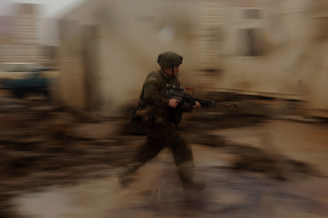An Australian soldier runs for cover while attacking Camp Raspberry. — © Tsgt Jeremy Lock/
