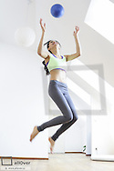 Young, pretty, sportive woman, coordination (model-released)