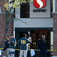 FBI agents continue to process the shooting scene in Tucson, Arizona January 11, 2011. REUTERS/Rick Wilking (UNITED STATES)