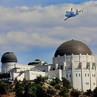 LOS ANGELES, CA SEPT. 21:  The Space Shuttle Endeavor, mounted atop a Boeing 747, flies over the Griffith Park Obervatory on Friday, September 21, 2012 in Los Angeles, California.  The Endeavor made its final journey from Kennedy Space Center in Florida to Los Angeles, while making farewell flights over San Francisco, Sacramento and down through various sights around L.A., and will be permanently housed at the Los Angeles Science Center. (Photo by Sandy Huffaker/Getty Images)