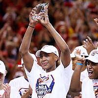 INDIANAPOLIS, IN - OCTOBER 21: Tamika Catchings #24 of the Indiana Fever hoists the MVP trophy after defeating the Minnesota Lynx during Game Four of the 2012 WNBA Finals on October 21, 2012 at Bankers Life Fieldhouse in Indianapolis, Indiana. NOTE TO USER: User expressly acknowledges and agrees that, by downloading and or using this Photograph, user is consenting to the terms and conditions of the Getty Images License Agreement. (Photo by Michael Hickey/Getty Images) *** Local Caption *** Tamika Catchings