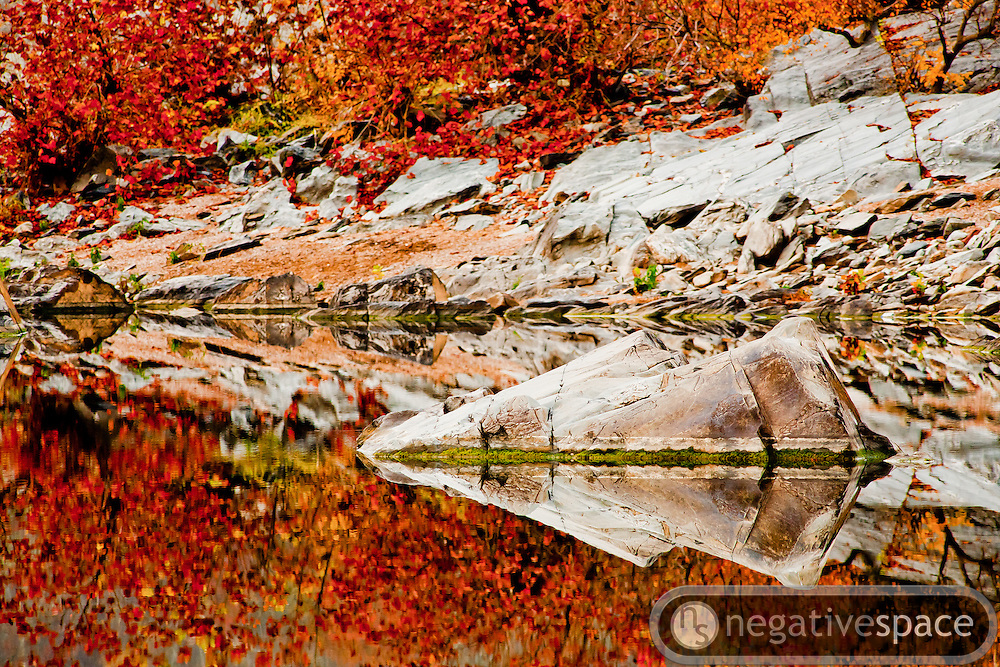 Arrowhead rocks reflection with fall foliage, Great Falls Park, Virginia