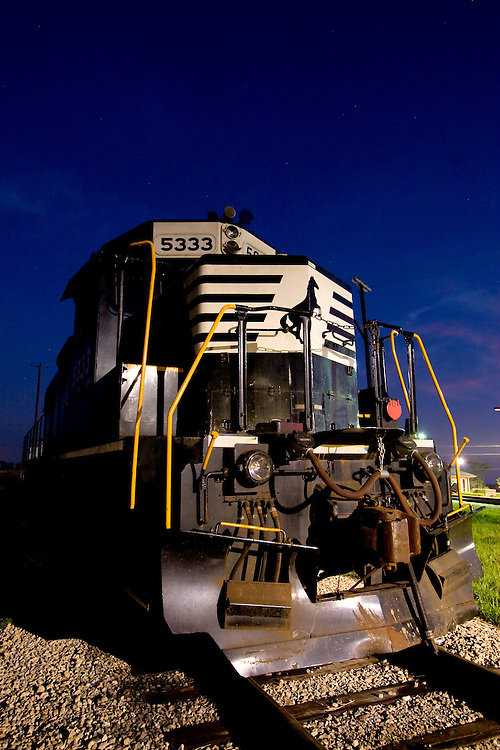 A Norfolk Southern locomotive idles on a quiet night in far suburban Manhattan, IL.