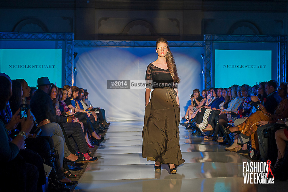 FASHION WEEK NEW ORLEANS: Designer Nichole Steuart show case her design on the runway at the Board of Trade, Fashion Week New Orleans on Wednesday March 19. 2014. #FWNOLA, #FashionWeekNOLA, #Design #FashionWeekNewOrleans, #NOLA, #Fashion #BoardofTrade, #GustavoEscanelle, #TraceeDundas #DominiqueWhite<br /> View more photos at http://Gustavo.photoshelter.com.