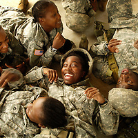 Soldiers sing songs together during some down time.