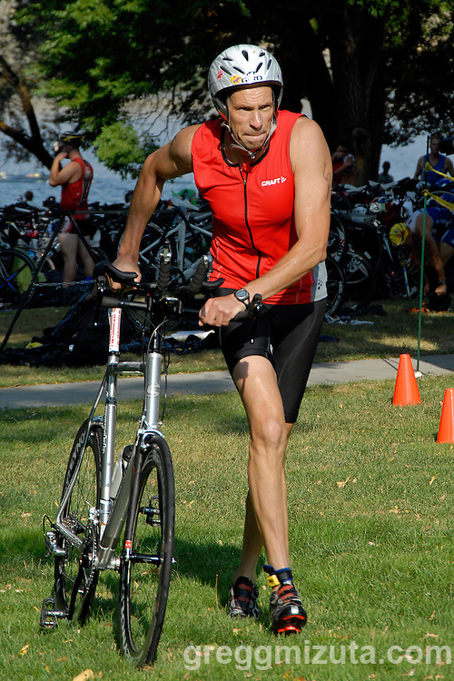 Hillard Zallen from Norwood Colorado leaves T1 during Emmett's Most Excellent Triathlon on August 7, 2010.<br /> <br /> Zallen finished the Olympic distance triathlon (1.5k swim, 40k bike and 10k run) in 2:30:18 to finish forty-fourth overall and fifth in the men's 40-44 age group.