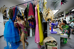 Performers preparing backstage before the Tiffany Show in Pattaya, Thailand 08 April 2009. The Tiffany show is one of the biggest transvestite cabaret show in Thailand with about 80 to 100 performers performing three shows every night for the past 33 years. Pattaya, a tourist hotspot known as a sex and entertainment city will host the ASEAN plus three and six summits including leaders of China, Japan, South Korea, India, Australia, and New Zealand, with South East Asian leaders from 10 to 12 April.