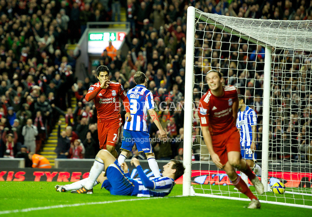 LIVERPOOL, ENGLAND - Saturday, February 19, 2012: Liverpool's Luis Alberto Suarez Diaz celebrates scoring the sixth goal against Brighton & Hove Albion during the FA Cup 5th Round match at Anfield. (Pic by David Rawcliffe/Propaganda)