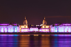 © Licensed to London News Pictures. 18/04/2017. LONDON, UK.  Greenwich landmarks: the Old Royal Naval College, the Queen's House, the National Maritime Museum and the Royal Observatory are seen lit up at night across the River Thames in south east London as boats pass by, to mark World Heritage Day 2017, which celebrates the international day for monuments and sites. This is the 20th anniversary of Maritime Greenwich being designated as a UNESCO World Heritage Site.  Photo credit: Vickie Flores/LNP
