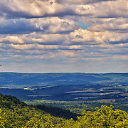 &quot;On a Highland Wind&quot;<br /> <br /> Wondrous beauty of the scenic Laurel Highlands of PA.! Gorgeous vistas from atop a mountain looking out into layers of puffy clouds, down into the valley below, and across to other mountains. Beautiful shadows and light dance across the landscape from the clouds and sunlight above as a falcon soars by on the wind!!<br /> <br /> Laurel Highlands Area of Pennsylvania by Rachel Cohen