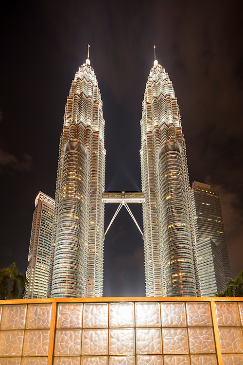 Malaysia, Kuala Lumpur, View from base of 88 story tall Petronas Tower at night, one of the world's tallest buildings at 452 meters or 1483 feet