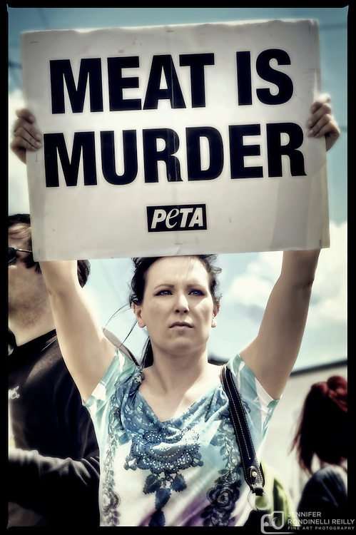 "People for the Ethical Treatment of Animals (PETA) stage a ""Meat is Murder"" protest in front of Cargill Meat Solutions Inc. on Canal Street in Milwaukee, WI. Photo © 2011 Jennifer Rondinelli Reilly. All Rights Reserved. NO USE WITHOUT PERMISSION."