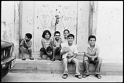 Palestinian children play in the streets of Qalqilya in the occupied West Bank.