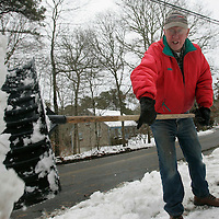 Centerville, MA -  Joe Cairns, Jr., 71-years-old, digs out the end of his driveway after Monday's snow storm.  Photo by Matthew Healey