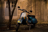 a 30 year old Vespa scooter in an alleyway in Kuching. The proud owner says it 'still runs great'.