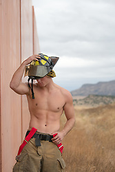 shirtless hunky muscular fireman without a shirt outdoors