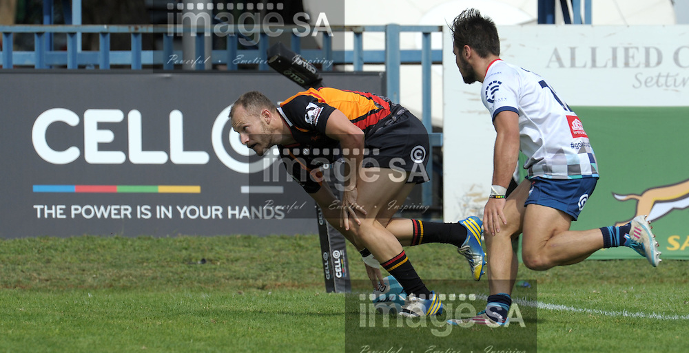 RURUSTENBURG, SOUTH AFRICA - Saturday 4 April 2015, KYLE DUTTON from Vaseline Wanderers scores a try  during the quarter-final losers playoff match of the Cell C Community Cup between Vaseline Wanderers and Jonsson College Rovers at the Impala Rugby Club in Rustenburg, South Africa.<br /> Photo by ImageSA/SARU