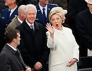 Former Secretary of State Hillary Clinton waves as she arrives with her husband former President Bill Clinton during inauguration ceremonies swearing in Donald Trump as the 45th president of the United States on the West front of the U.S. Capitol in Washington, U.S., January 20, 2017. REUTERS/Rick Wilking TPX IMAGES OF THE DAY - RTSWLL5