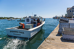 Captain Mike Mesko and sternwoman, Lillian Saul aboard 'Evening Call' at the Vinalhaven Fishermen's Co-op in Vinalhaven, Maine.