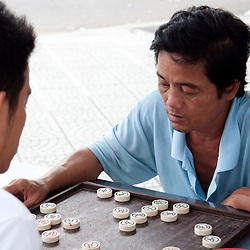 HUE, VIETNAM - SEPTEMBER 4: Unidentified man plays a chess game on the streets of Hue, on September 4, 2010. The chairman of the Vietnam Chess Federation said the government spends US$3 million a year to promote the game