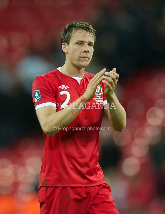 LONDON, ENGLAND - Tuesday, September 6, 2011: Wales' Chris Gunter applauds the fans after the 1-0 defeat to England during the UEFA Euro 2012 Qualifying Group G match at Wembley Stadium. (Pic by David Rawcliffe/Propaganda)