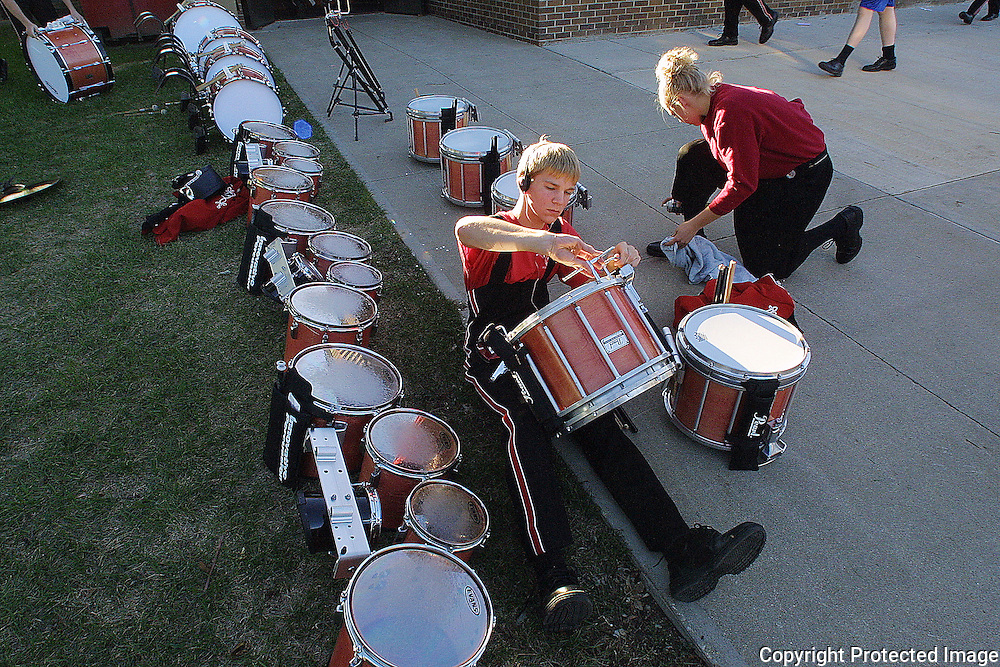 Band members ready their instruments before homecoming.