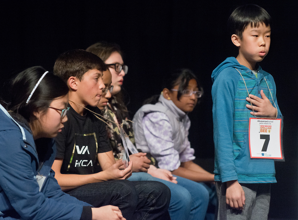Garrick Tam, right, a 3rd grader at Hawthorne Elementary in Albuquerque, takes a deep breath before stepping up to the microphone to compete in the 2017 New Mexico Spelling Bee at Sandia Prep, Saturday, March 18, 2017. (Marla Brose/Albuquerque Journal)