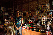 Myanmar. Young woman in her home. A room in an old colonial office in the heart of Yangon.