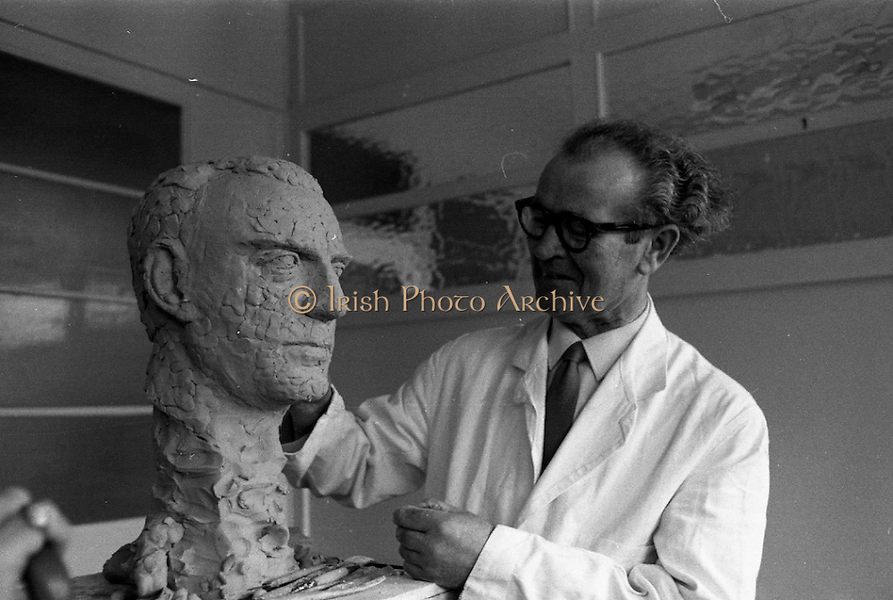 Sculptor Seamus Murphy at work. Murphy has been commissioned by the staff of the New Ireland Assurance Company to make a bronze bust of Dr. M.W. O'Reilly, Chairman and Managing Director of the company. The bust will be presented to Dr. O'Reilly to mark the Golden Jubilee of the New Ireland Assurance Company.31.01.1968