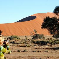Africa, Namibia, Sossusvlei. Photographer at Sossusvlei.