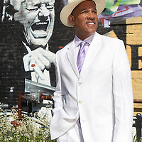 """""""Con Salsa!"""" host José Massó, is seen in front of a mural of musician Tito Puente in Boston, Friday,  May 28, 2010."""