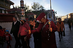 A picture made available on 19 September 2016 of Tibetan nuns walking around the Jokhang Temple in the early morning in Lhasa, Tibet Autonomous Region, China, 09 September 2016. Jokhang Temple is considered one of the most sacred site for Tibetan buddhists built during the rule of King Songtsen Gampo in the 7th century.