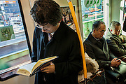 Commuters in a train of Yamanote line that circles Tokyo