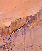 0100-1006 ~ Copyright: George H. H. Huey ~ Anasazi pictographs [in white], Navajo pictographs [brown], near Antelope House, Canyon del Muerto. Canyon de Chelly National Monument, Arizona.