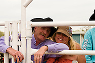 Cowboy and Cowgirl couple having fun, Miles City Bucking Horse Sale, Rodeo, Montana