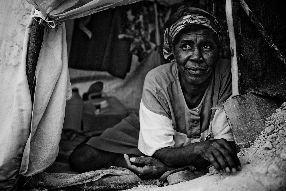 A woman rests in her tent a camp for those displaced by the recent earthquake in Petionville, outside Port-au-Prince, Haiti.