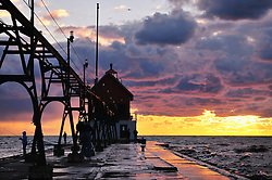 Fishermen enjoy a September night on the south pier at Grand Haven, Michigan