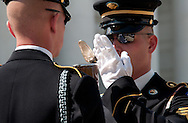 """An inspecting officer (right) with the United States Army's 3rd Infantry Regiment Honor Guard or """"Old Guard"""" inspects the rifle of a sentry during a changing of the guard ceremony at the Tomb of he Unknowns in Arlington National Cemetery in Arlington, VA on Saturday, April 26, 2014."""