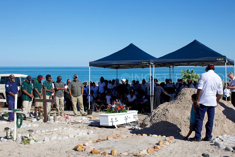 A funeral in Ardyaloon ( One Arm Point community). One Arm Point has a small but beautiful graveyard in the sand dunes behind the community. One Arm Point community, WA