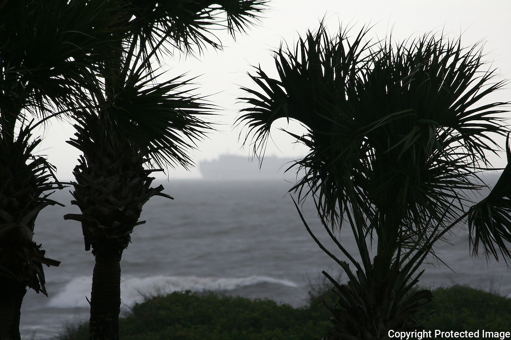A ghost ship sailing through the fog, off the shore of a Jekyll Island beach