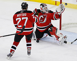 Apr 23, 2009; Newark, NJ, USA; New Jersey Devils goalie Martin Brodeur (30) makes a glove save during the third period of game five of the eastern conference quarterfinals of the 2009 Stanley Cup playoffs at the Prudential Center. The Devils beat the Hurricanes 1-0 to take a 3-2 lead in the best of 7 series.