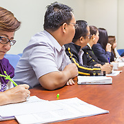CAPTION: ICLEI, ACCCRN's implementing partner in the Philippines, has engaged multiple departments of the Makati City Government to establish a Climate Core Team, various of whose members are seen meeting here. The organisation has trained the team to identify urban systems and communities that are vulnerable to climate change impacts. One of the main achievements of ICLEI's involvement so far has been to raise awareness within the Makati City Government about how climate change can affect the city. The team is now due to put together a City Resilience Strategy, which will essentially entail 'climate proofing' all of the city's existing plans, resulting in a series of integrated local climate change action plans. LOCATION: Makati City Hall, Makati, Metro Manila, Philippines. INDIVIDUAL(S) PHOTOGRAPHED: Nida Cruz (left).