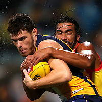 PERTH, AUSTRALIA - MAY 16: Tom Nicholls of the Suns tackles Luke Shuey of the Eagles during the round seven AFL match between the West Coast Eagles and the Gold Coast Suns at Domain Stadium on May 16, 2015 in Perth, Australia.  (Photo by Paul Kane/Getty Images)