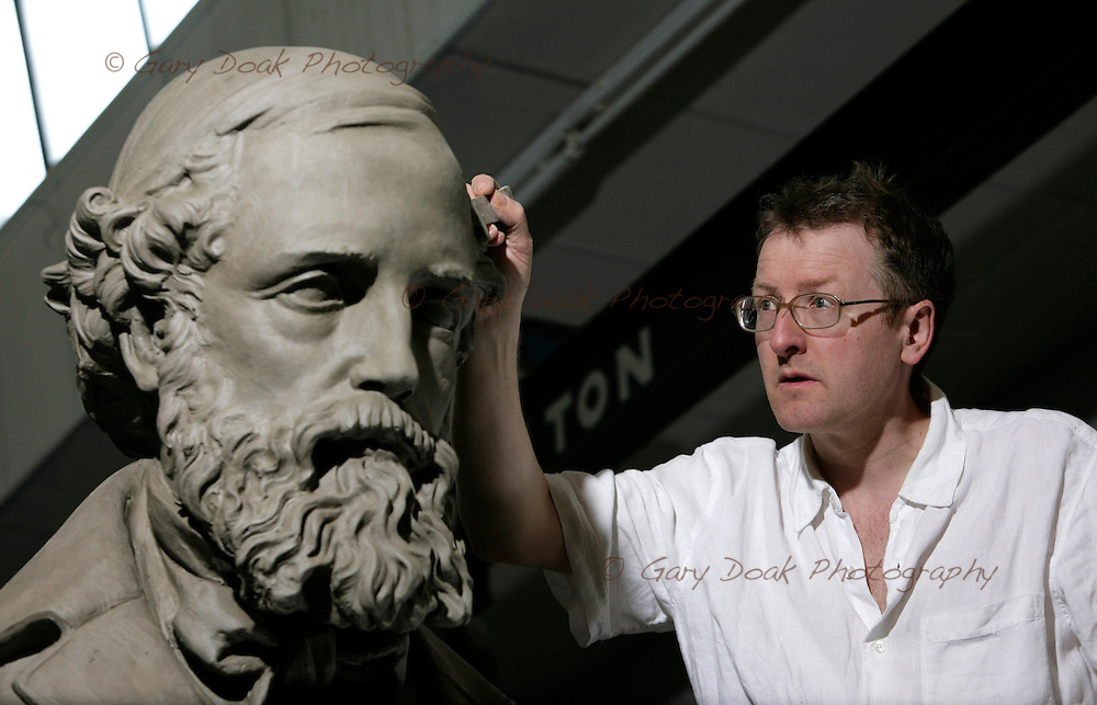 SCULPTOR SANDY STODDART PUTS THE FINISHING TOUCHES TO THE CLAY VERSION OF HIS STATUE OF JAMES CLERK MAXWELL..Picture © GARY DOAK.19/05/08..tel.+44 7836 255728.gary@garydoak.com.