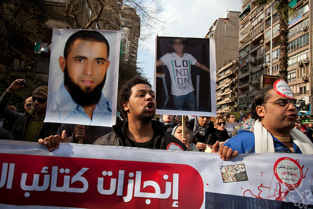 Egyptian activists chant anti-military slogans and  carry pictures of the martyrs killed by the military during a January 20, 2012 protest march outside the Mustafa Mahmoud mosque in Cairo, Egypt. The hundred or so protestors marched on Tahrir square to join larger crowds there, and similar marches took place across Cairo with the intent on building momentum before next week's one year anniversary of the revolution.(Photo by Scott Nelson)