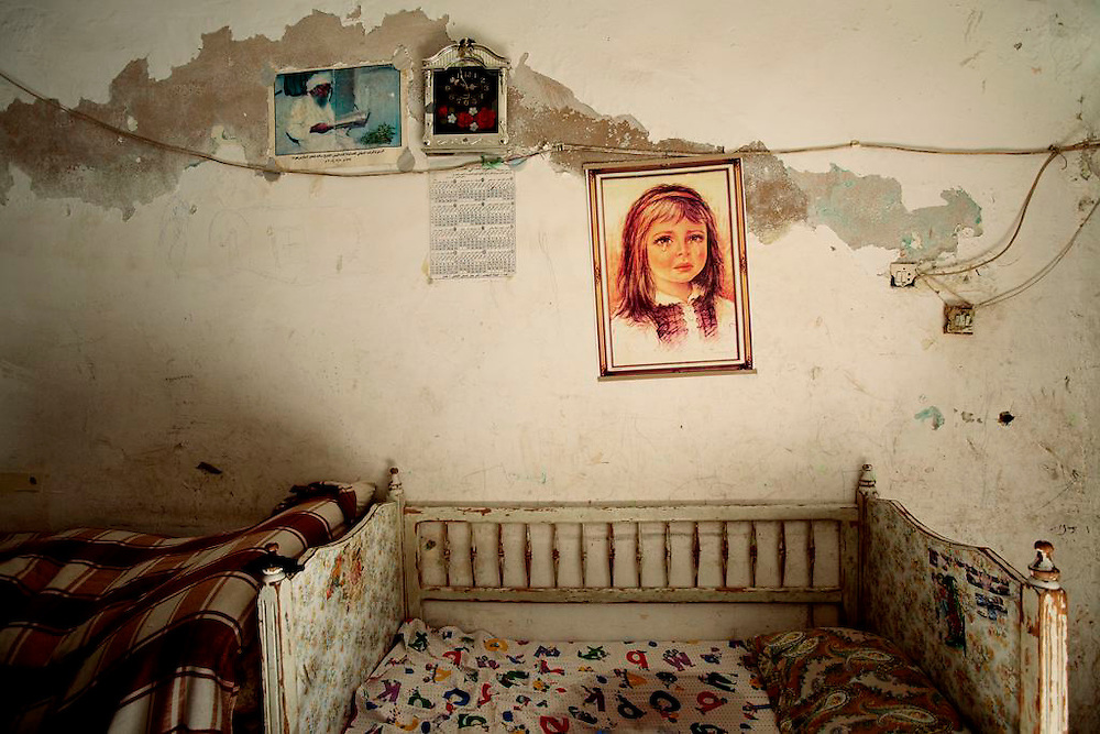 Poster of girl with Tear decorates the<br /> apartment of Fatin, Samir and their four children.<br /> Amman, Jordan<br /> 