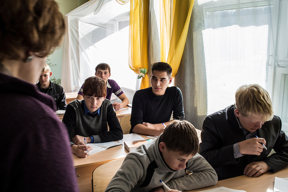 Students listen as their teacher speaks in a Russian language class on Wednesday, October 23, 2013 in Baikalsk, Russia.